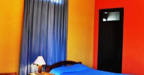Make cheap reservations at a hostel like Hostal Posada Del Parque
