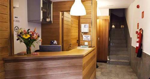 Make cheap reservations at a hostel like Pension San Fermin